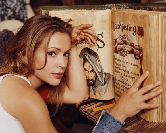 Alyssa Milano as Phoebe in Charmed, reading the Book of Shadows (Book-o'-Shadows, as she pronounced it)